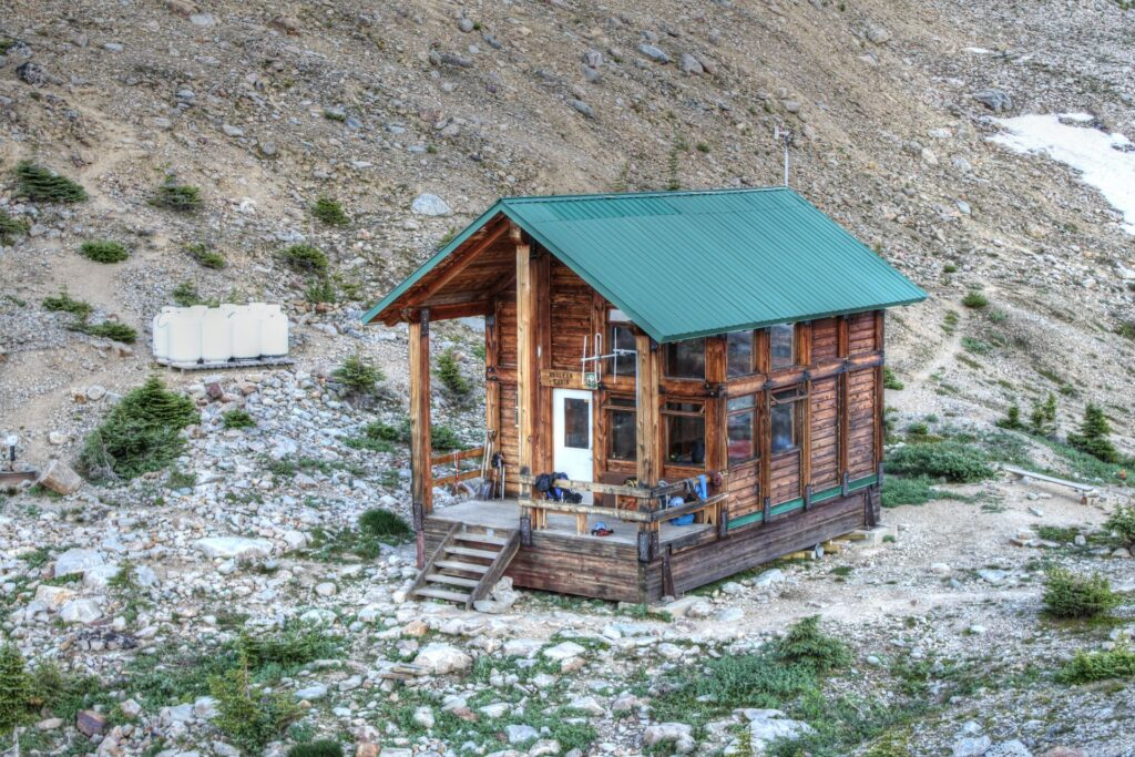 Asulkan Hut sits on a rocky outcrop in the Selkirk Mountains